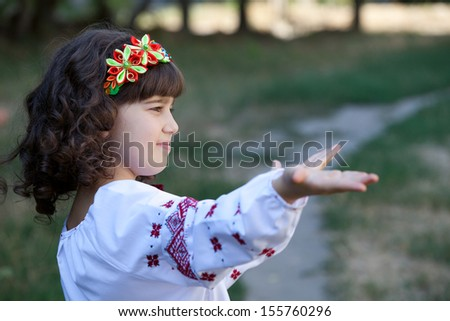 cute girl invite to travel, welcome to Ukraine - stock photo