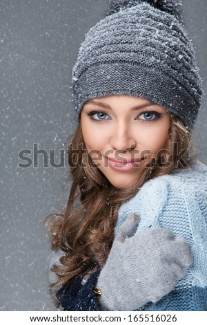 Cute girl is happy to see snowflakes - stock photo