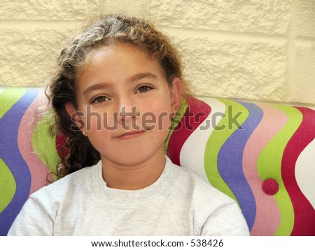 Cute girl on a couch - stock photo