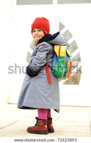 Cute girl outdoor, going to kindergarten - stock photo