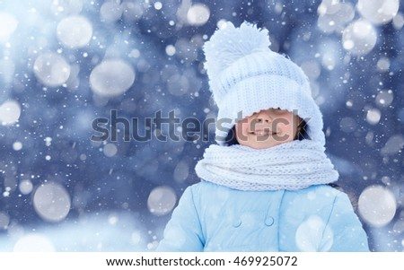 Cute girl outdoor in winter. Winter holiday concept.