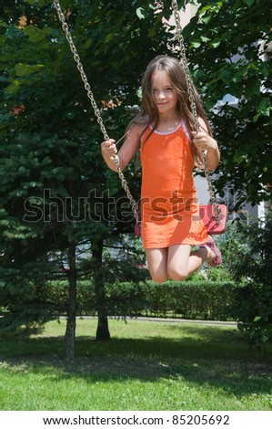 cute girl playing on the playground - stock photo