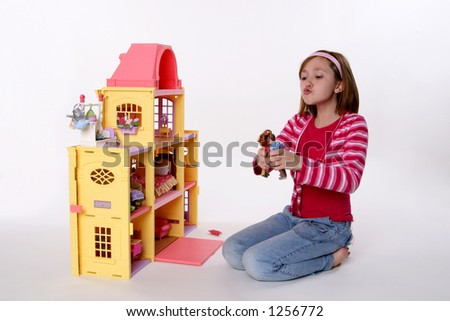 cute girl playing with dolls - stock photo
