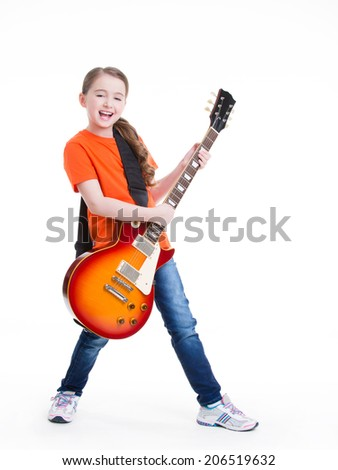 Cute girl plays on the electric guitar with bright emotions isolated on white background. - stock photo