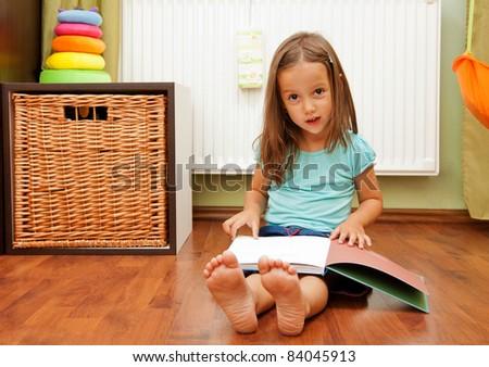 cute girl reading a book - stock photo