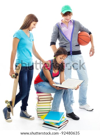 Cute girl reading while her friends offering her to go out - stock photo