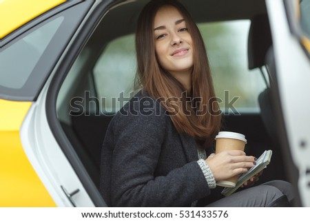 Cute girl sitting in taxi