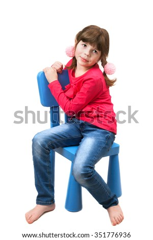 cute girl sitting on a chair isolated on white background - stock photo