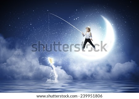 Cute girl standing on moon with fishing rod - stock photo