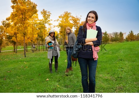 Cute girl student with books in college park - stock photo