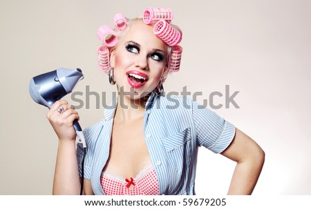 Cute girl styling hair, similar available in my portfolio - stock photo