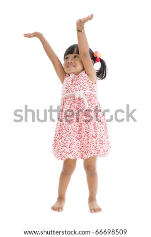 cute girl trying to reach something, isolated on white background - stock photo