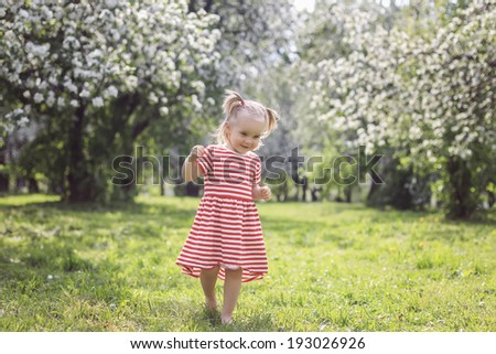 Cute girl walking in the park on a summer day - stock photo