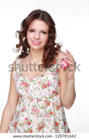 Cute girl wearing clothes with floral ornament/Emotional girl holding a small gift on white background - stock photo