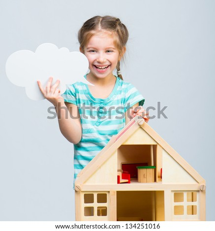cute girl with a toy house holding cloud talk - stock photo