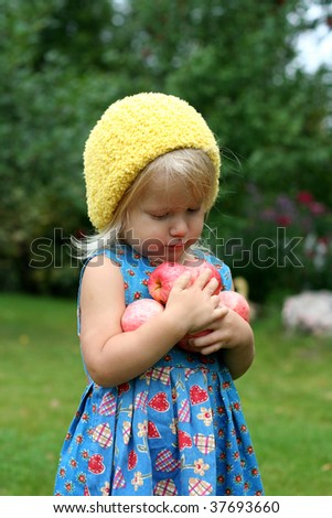 Cute girl with apples in her hands - stock photo