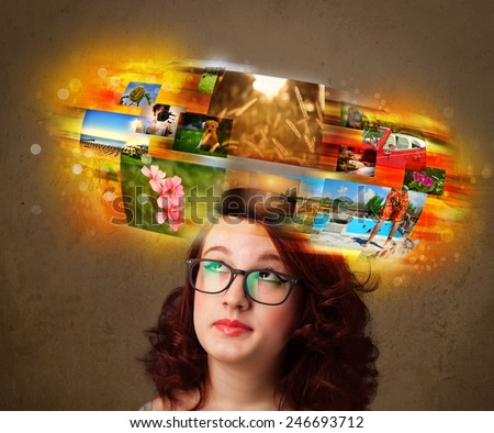 Cute girl with colorful glowing photo memories concept - stock photo