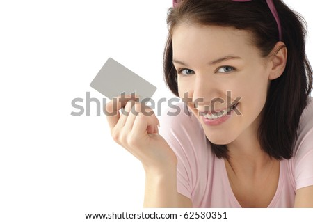 Cute girl with credit card - stock photo