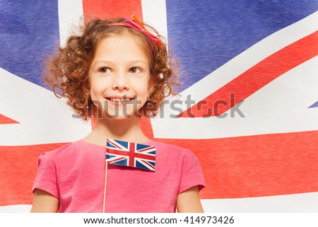 Cute girl with flag, banner of England behind