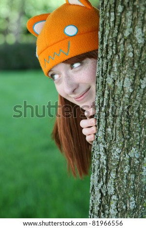cute girl with freckles and animal hat smiling - stock photo