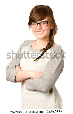 Cute Girl With Glasses - This is a photo of a cute young girl with glasses and braided hair smiling at the camera in a comfortable sweatshirt. Shot on an isolated white background. - stock photo