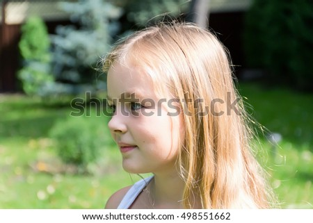 Cute girl with gold long hair and blue eyes