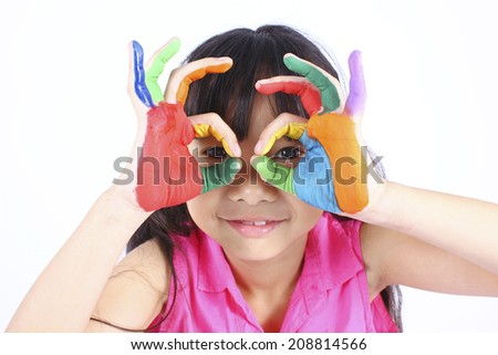 Cute girl with hands in the paint