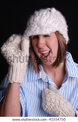 Cute Girl with Mittens and Hat Winking - stock photo