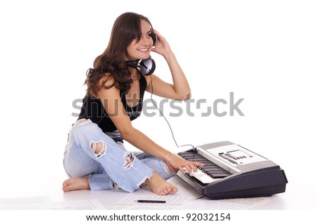 cute girl with piano and texts on white - stock photo