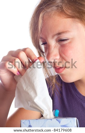 Cute girl with the sniffles taking a tissue - stock photo