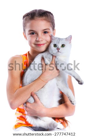 Cute girl with white cat smiling at camera on isolated white background