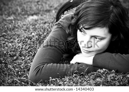 Cute green eyed woman on the grass - stock photo