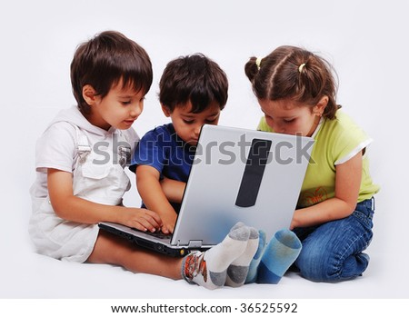 Cute group of children are playing and learning on laptop
