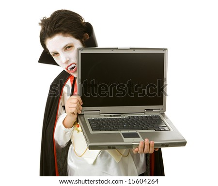Cute Halloween vampire holding a laptop computer over white background.  LCD screen is blank and ready for your text. - stock photo