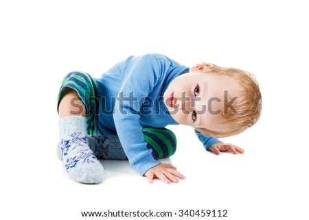 Cute happy baby blonde in a blue sweater playing and smiling, isolated on a white background - stock photo