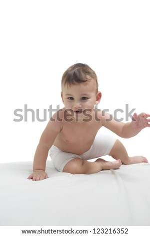 Cute happy baby gambling on a white towel - stock photo