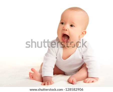 cute happy baby with open mouth laughs, shouting on a white background - stock photo