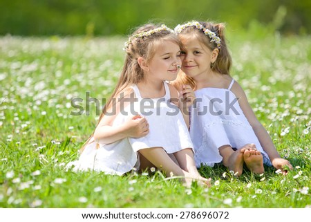Cute happy children playing in spring filed - stock photo