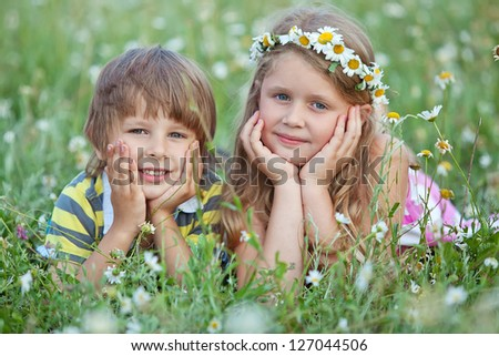 Cute happy children playing in spring nature - stock photo