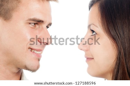 Cute happy couple looking at each other isolated on white. - stock photo