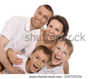Cute happy family posing isolated on white background