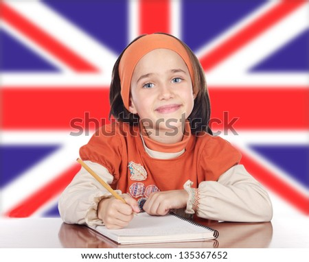 Cute Happy Girl Studying In Front Of British Flag