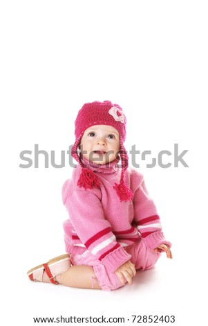 Cute happy laughing baby girl in funny pink hat isolated on white background - stock photo