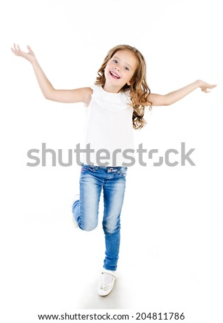 Cute happy little girl in jeans isolated on white