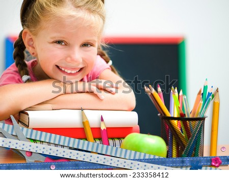 cute happy little girl  on education  background - stock photo