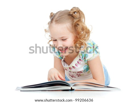 cute happy little girl reading a book - stock photo