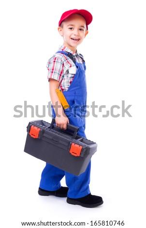 Cute happy little handyman walking with toolbox - stock photo