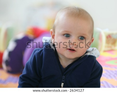 Cute happy 6 month old baby playing - stock photo