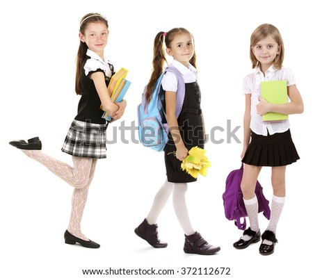 Cute happy schoolgirls, isolated on white - stock photo