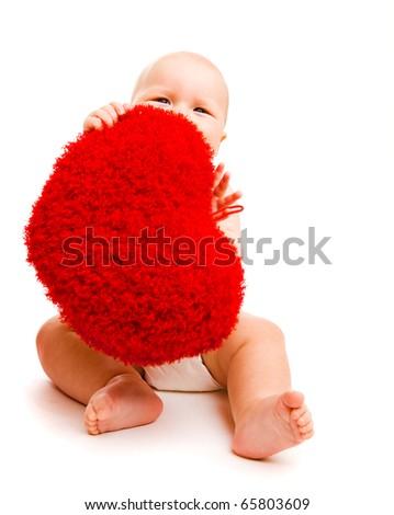 Cute happy valentine baby hiding behind fluffy heart - stock photo
